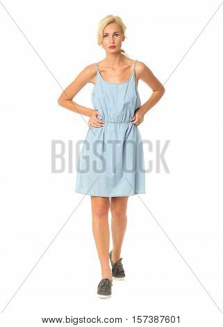 Portrait Of Flirtatious Woman In Blue Tunic Dress Isolated On White