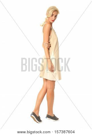 Portrait Of Flirtatious Woman In Yellow Summer Dress Isolated On White