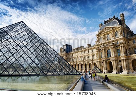 The View Of The Passage Richelieu And The Pyramid Of The Louvre, Paris.