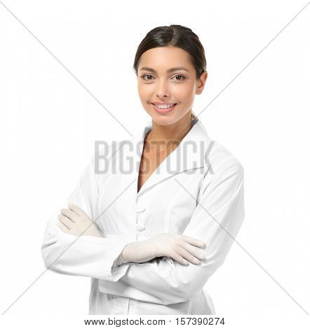Young female dentist wearing in uniform isolated on white