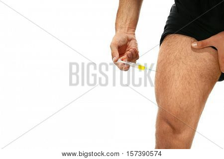 Muscular man injecting steroids, closeup