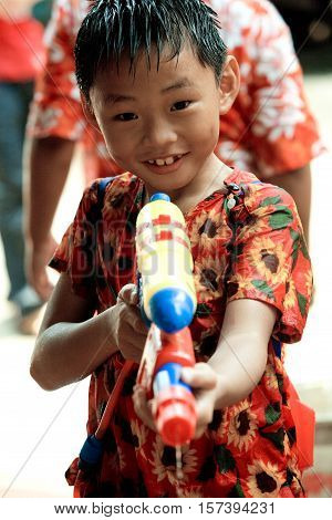Bangkok, Thailand - April 13, 2008 :  Children play with water guns during Songkran, the Thai New Year's festival.