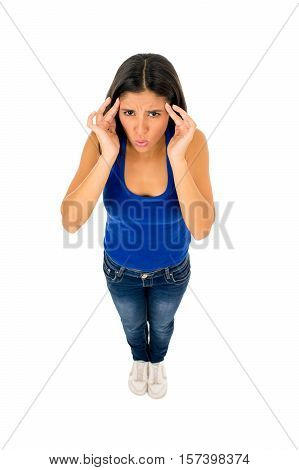 young stressed attractive hispanic woman in casual top and jeans touching tempo with fingers suffering headache and migraine looking worried isolated on white background