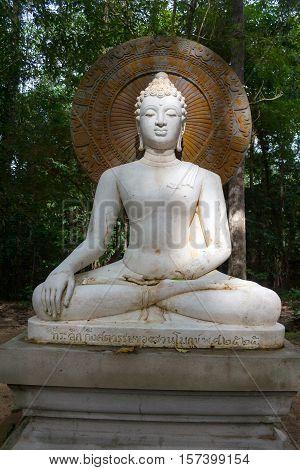 Buddha face of budda statue in Suan Mokkh Buddhist temple