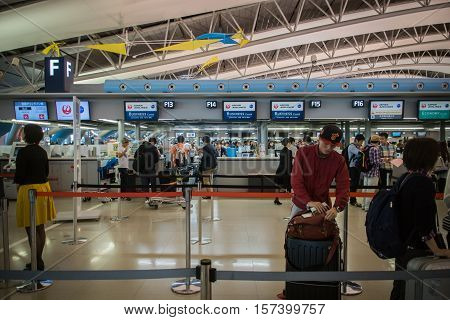 Osaka, Japan - November 2016: Passengers at JAL, Japan Airlines, check-in counter at  Kansai International Airport (KIX), Osaka, Japan. JAL, Japan Airlines, is the flag carrier airline of Japan and the second largest airline.  Kansai Airport is one of the