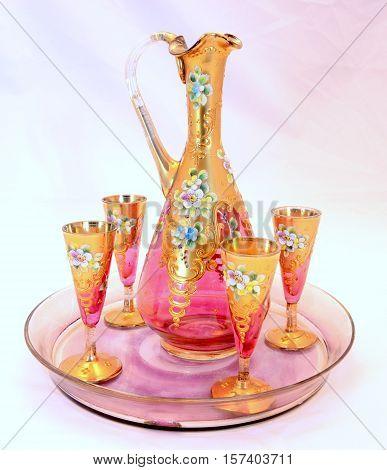 beautiful gilded vintage patterned jug of wine glasses