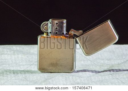 Iron Lighter On A Black And White Background