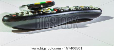 tv remote control black on white background