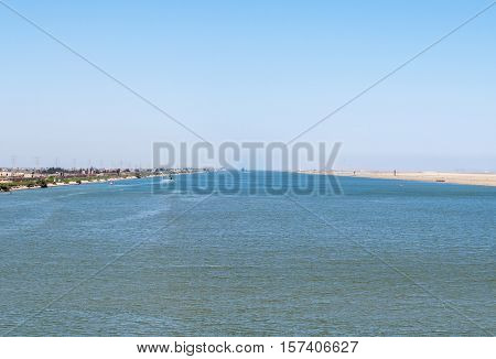 Suez canal. The Suez Canal is an artificial sea-level waterway in Egypt, connecting the Mediterranean Sea to the Red Sea through the Isthmus of Suez.