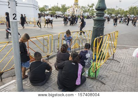 BANGKOK THAILAND - OCT 28 : snap shot of mourners on Sanam Chai road road in Sanam Luang area while the funeral of king Bhumibol Adulyadej in Grand Palace on october 28 2016