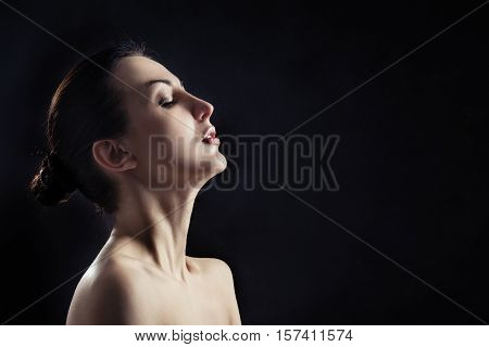 sensual aroused woman profile on black background with copyspace
