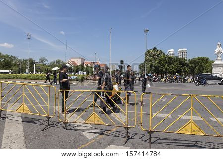 BANGKOK THAILAND - OCT 23 : snap shot of people at Ratchadamnoen Klang road on the way to Sanam Luang while the funeral of king Bhumibol Adulyadej in Grand Palace on october 23 2016