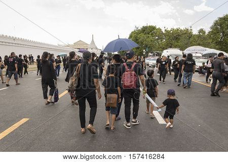 BANGKOK THAILAND - OCT 23 : The mourners on Na Phra Lan road in Sanam Luang area while the funeral of king Bhumibol Adulyadej in Grand Palace on october 23 2016