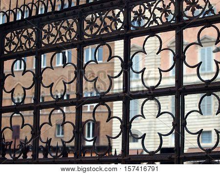 Siena - decorative grating on Piazza del Campo