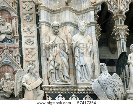 Architectural details of Duomo facade - SienaTuscanyItaly. The Duomo of Siena which was built in the 12th and 13th centuries is one of the prettiest churches in Gothic style in Italy