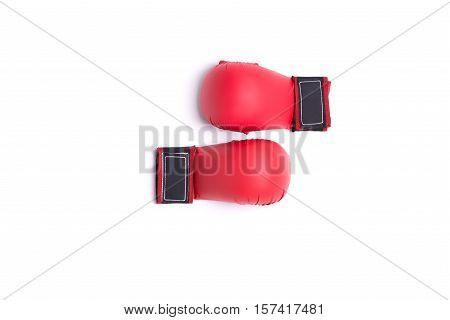 two fighting red gloves of karateka lies