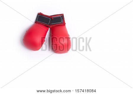 two fighting red gloves of karateka lie