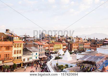 Kathmandu, Nepal - OCTOBER 25, 2016: Buildings at the Boudhanath square in Kathmandu, Nepal.
