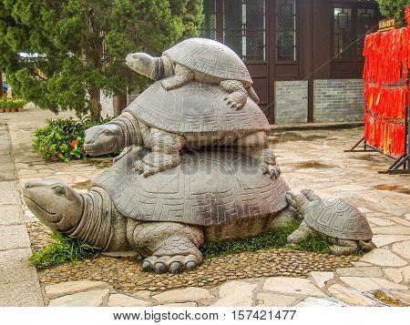 Three turtles statue at Hainan Park of longevity as symbol of family generations