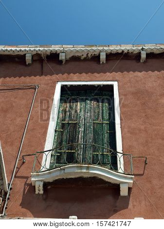 Venice - balcony with wooden shutters in Murano