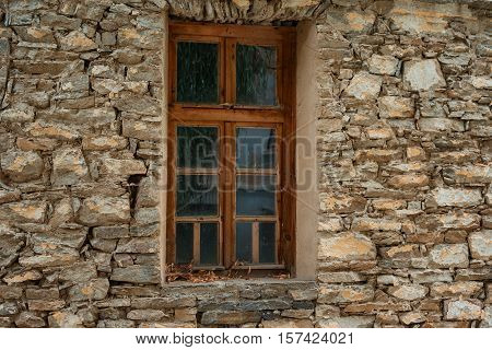 Window at one old Bulgarian house in the village of Kovachevitsa, Bulgaria