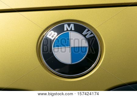 TURIN, ITALY - JUNE 9, 2016: BMW logo on a yellow car body
