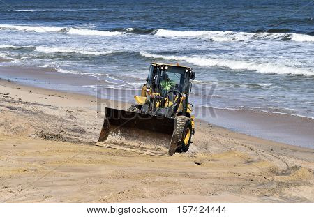 VILANO BEACH, FLORIDA, USA - OCTOBER 19, 2016: Heavy construction equipment clearing beach debris caused by hurricane Matthew hitting the east coast of Florida on October 7. 2016.