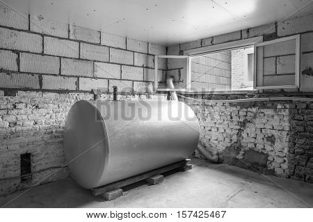 in a separate room in a old building there is a heating oil tank