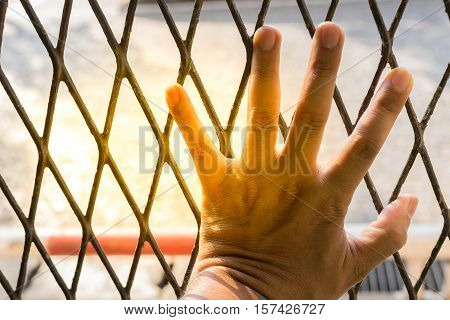 Hands Of The Man On A Steel Lattice Close Up