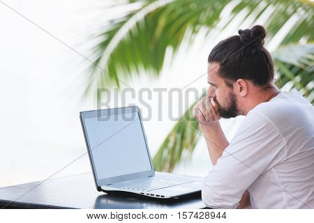 telecommuting, businessman relaxing on the beach with laptop and palm, freelancer workplace, dream job