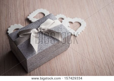 Jewelry gift box on a wood background