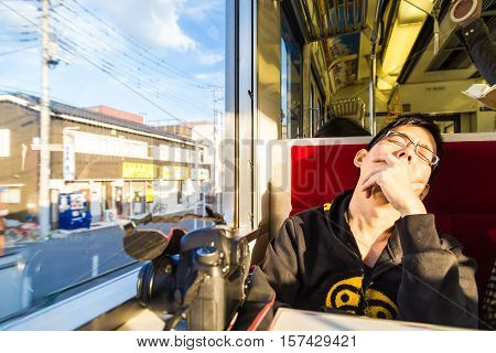 Photographer Asian Man Sleep On The Train With His Camera