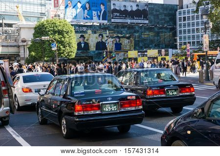 Tokyo Japan - October 24: Taxi car at Shibuya Crossing on October 24 in Tokyo Japan 2016 . Shibuya Crossing is one of the busiest crosswalks in the world.
