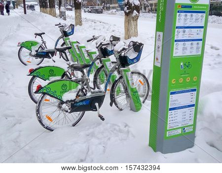ALMATY KAZAKHSTAN - November 20 2016: The automated station rental bike under the snow in the city of Almaty Kazakhstan
