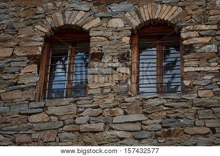 Windows at one old Bulgarian house in the village of Kovachevitsa, Bulgaria