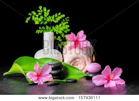 Beautiful Spa Composition Of Pink Hibiscus Flower, Leaf Fern, Thai Herbal Compress Ball, Towel, Cand