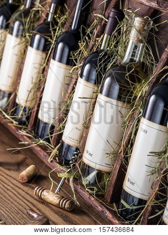 Wine bottles on the wooden shelf. Vintage wine.