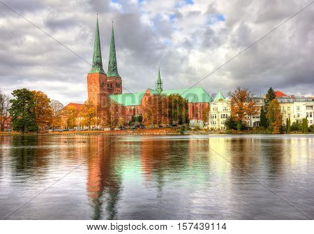 Lubeck, Beautiful Old Town Reflected In Trave River, Germany