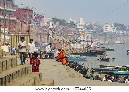 VARANASI INDIA - DEC 10 2010: Hindu people wash themselves in the river Ganga in the holy city of Varanasi