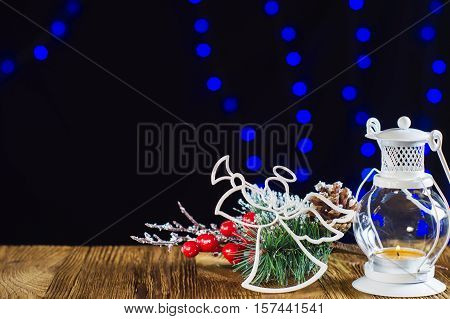 The template for Christmas greetings card with white Christmas angel fir twigs cones and Christmas holly . Xmas baubles. Merry Christmas background. New year still life.
