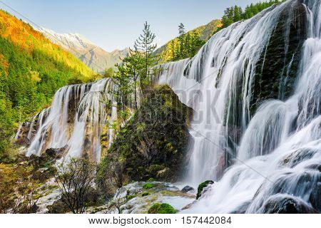 Beautiful View Of The Pearl Shoals Waterfall And Woods At Sunset