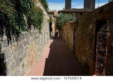 Narrow passage in San Gimignano in Tuscany Italy