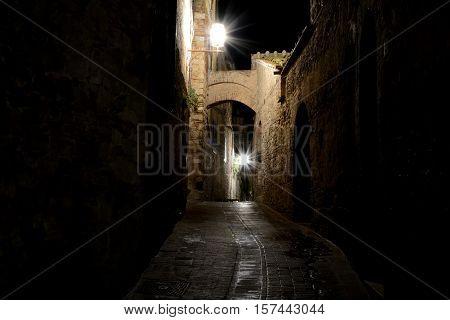 Narrow passage at night in San Gimignano in Tuscany Italy