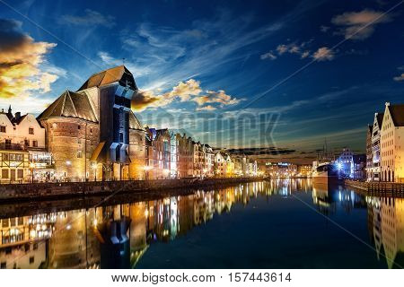 The riverside with the characteristic Crane of Gdansk Poland.
