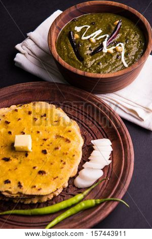corn flour flat bread or roti or Makki Ki Roti with sarso da Saag or mustard leaves curry, Indian Food popular in winter season in north india
