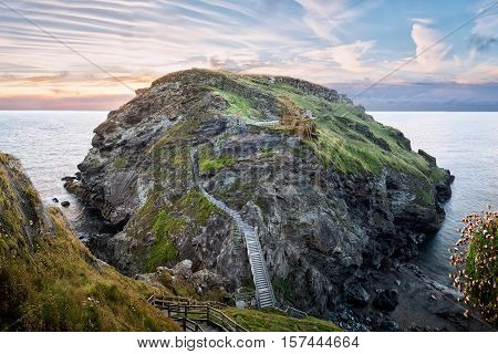 Peninsula of Tintagel Island and legendary castle ruins at sunset