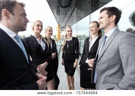 Business team talking on a balcony work pause concept