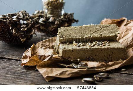 sunflower seeds in a dry. dark wood background. paste of sunflower seeds