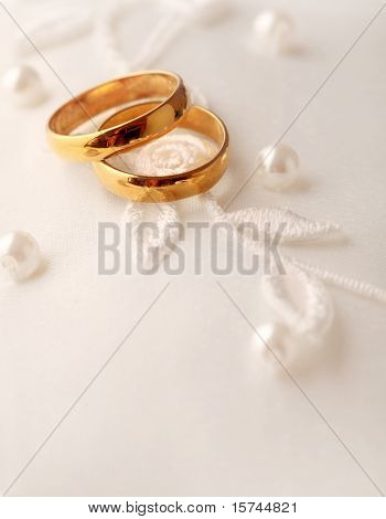 two wedding rings and wedding background