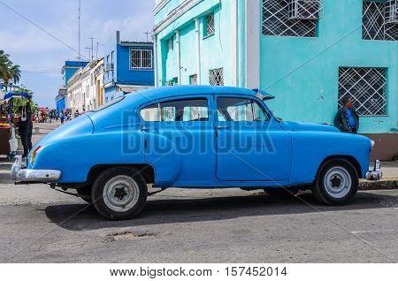 CIENFUEGOS, CUBA - MARCH 22, 2016: Blue vintage automobile parked in Cienfuegos Cuba